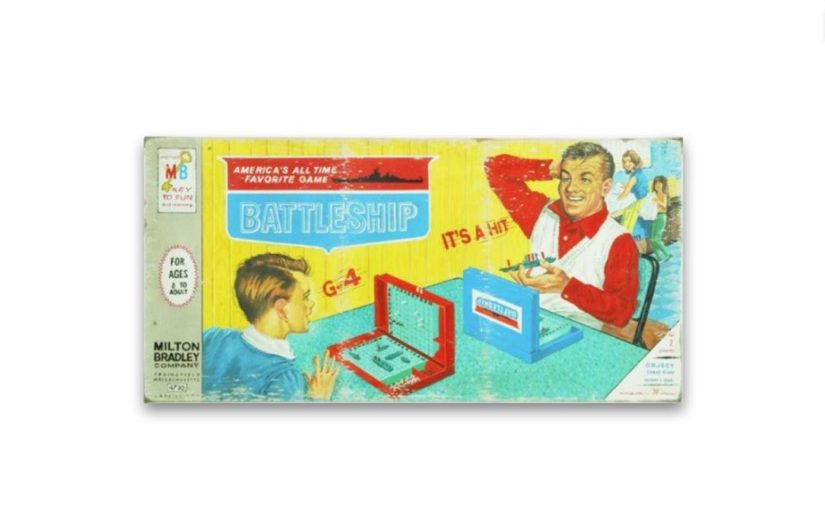 A picture of an older version of the Battleship boardgame box cover, whose covers shows a father and son playing the boardgames while a wife and daughter do chores in the kitchen.