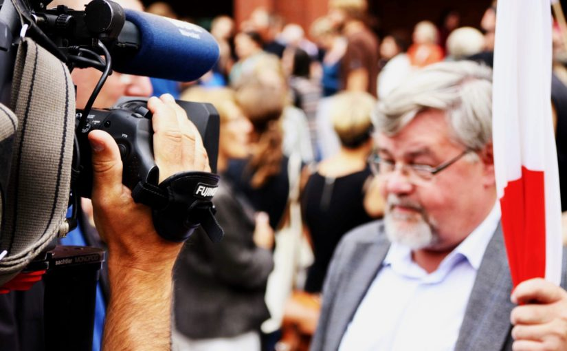 "A picture of a news cameraperson in a crowd from Nick Byrd's ""The Bias Fallacy""."